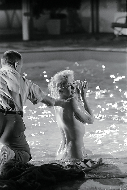 "Marilyn poolside during the ""Something's Got To Give"" photoshoot, May 1962."