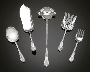 Serving pieces from the Martelé silver flatware service, one of only two known full flatware services Gorham ever made.