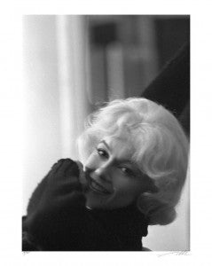 "This candid of Monroe was taken in 1960 behind the scenes of ""Let's Make Love"""