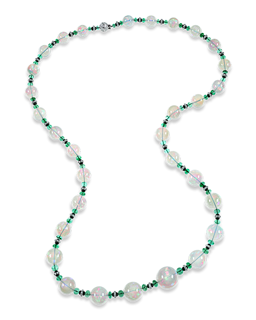 """This graduated opal bead necklace features 31 opl beads weighing 493 total carats. Measuring just over 35"""" length, this opera-length necklace exudes luxury."""