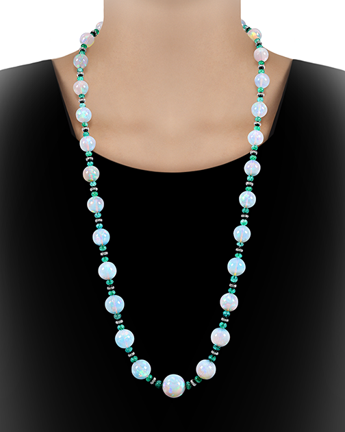 "This graduated opal bead necklace features 31 opl beads weighing 493 total carats. Measuring just over 35"" length, this opera-length necklace exudes luxury."