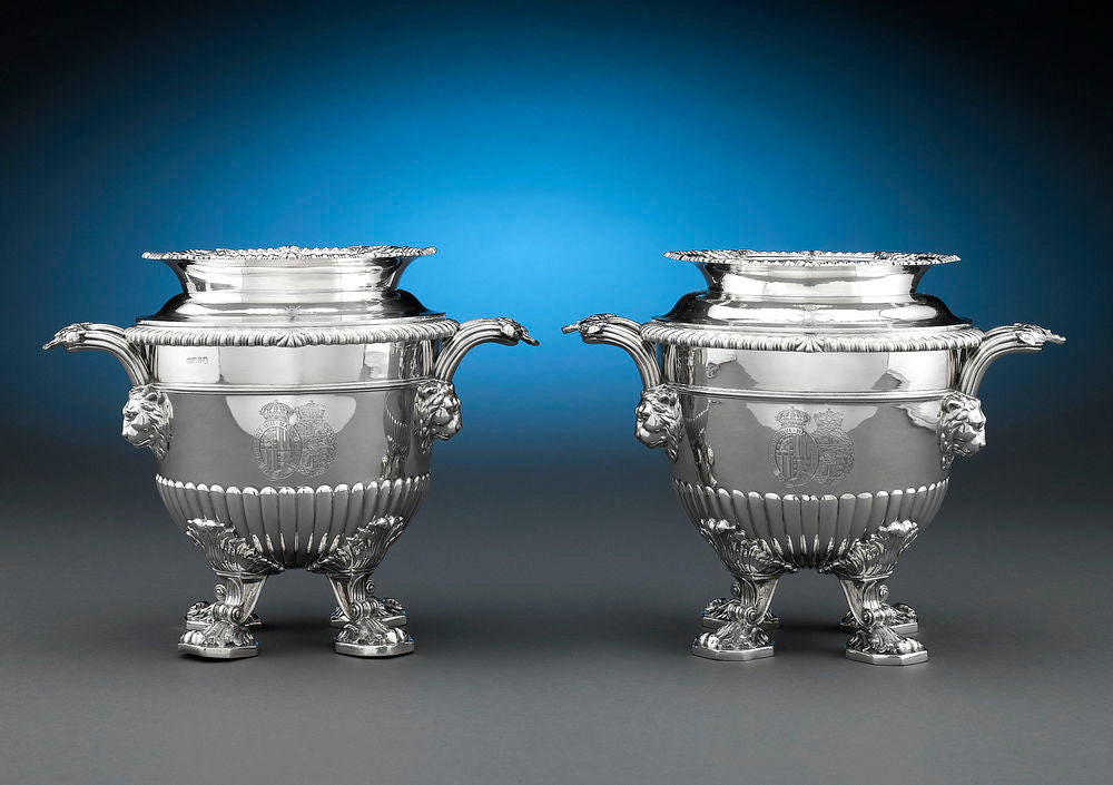 These incredible silver wine coolers were owned by HRH Princess Beatrice, the youngest daughter of Queen Victoria and Prince Albert. The coat-of-arms of Princess Beatrice and her husband Prince Henry of Battenberg are engraved upon each.