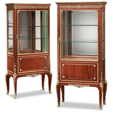 Paul Sormani's superb craftsmanship is most evident in this exquisite pair of mahogany vitrines