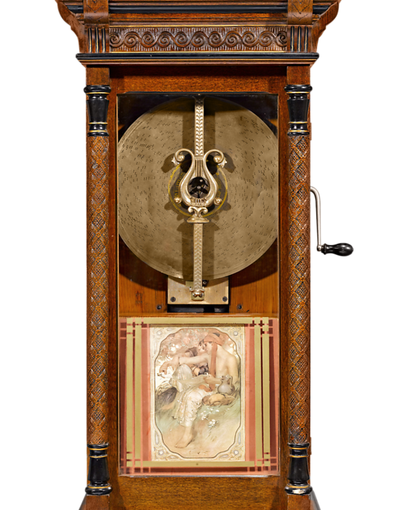 Close up of the Symphonion disk music box within its artfully constructed upright cabinet.