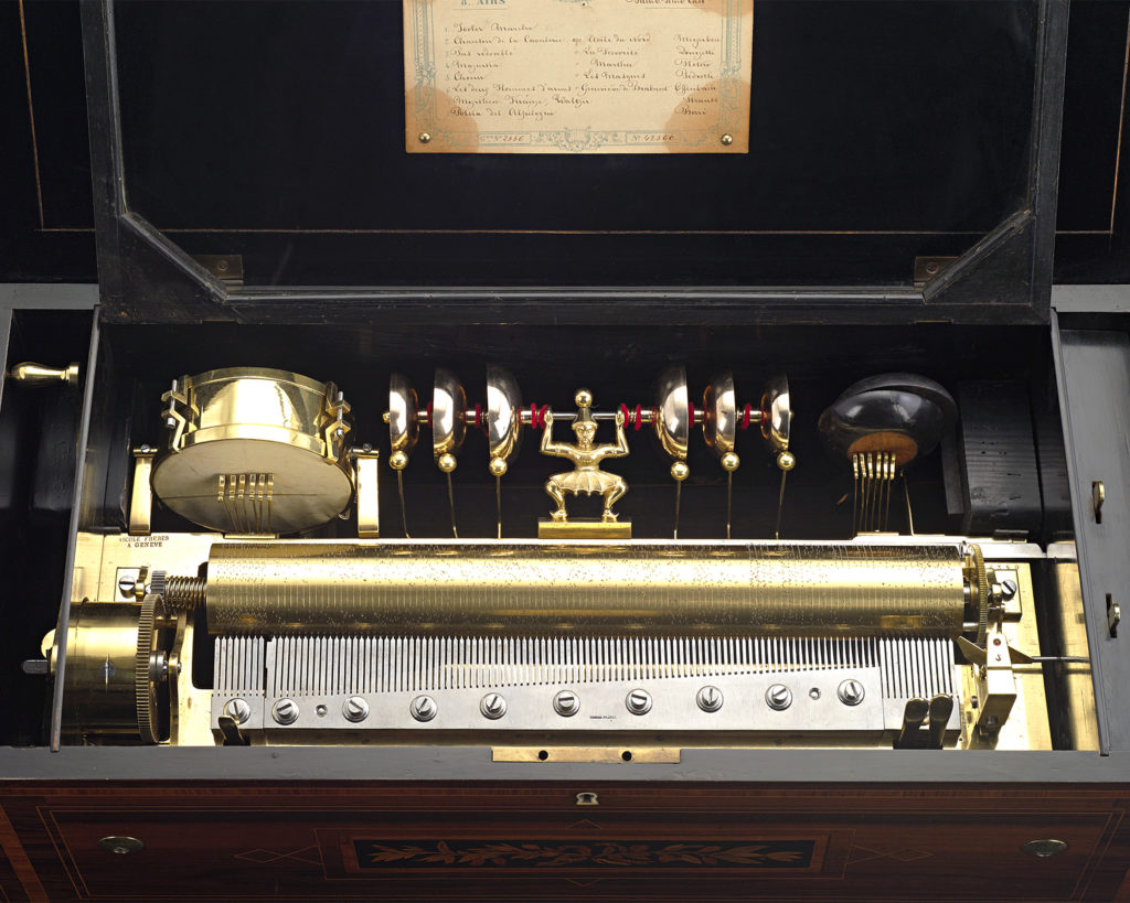"Nicole Frères ""triple signed"" cylinder music box, interior. The cylinder is accompanied by bells, a drum and castanets, and can play 8 songs on a single cylinder."