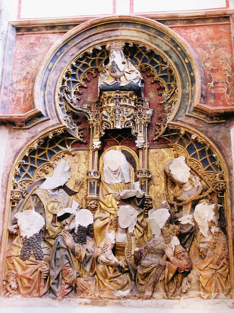 Altarpiece in St. Martin's Cathedral. The figures' heads were removed as a result of Reformation iconoclasm in the 16th century.