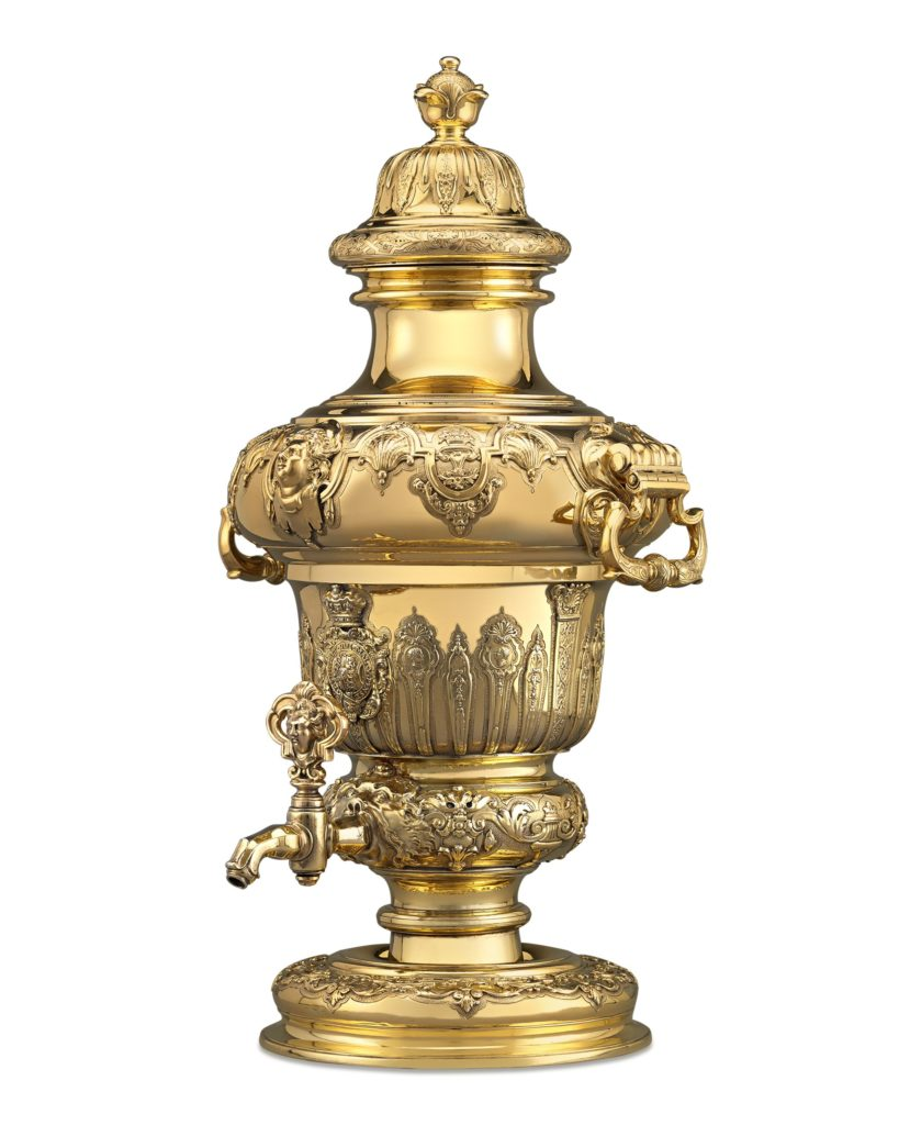 The Royal Silver Gilt Wine Fountain made in the 18th century for the Royal Collection during the reign of King George I. Later, King George IV, then Prince of Wales, used it for his Royal Banquets, having his coat of arms applied to the piece.