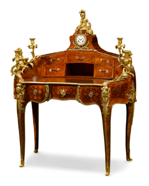 With its curved shape, intricate rosewood marquetry and gilded ormolu decoration, this lovely desk is an excellent example of the Louis XV style. It was created by the renowned Theodore Millet, founder of the widely acclaimed Maison Millet in Paris.