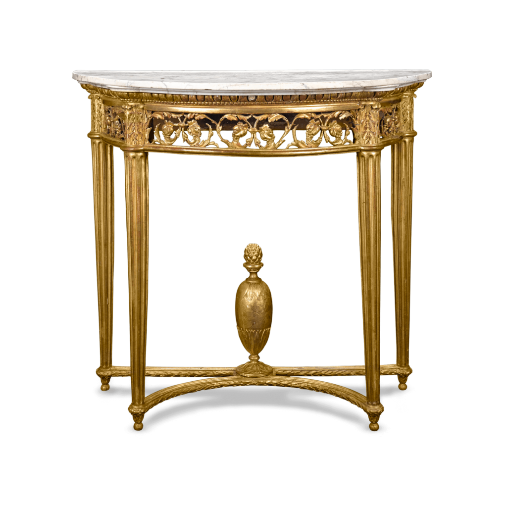 Neoclassical influence is evident in this lovely giltwood console table. With it's delicate floral motif, column style legs, and lightweight structure it embodies the principles of symmetry and simplicity so prized in the Louis XVI era.