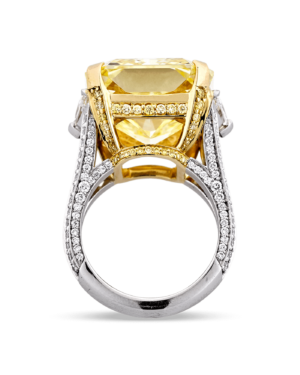Compressed air would be a great tool to use when cleaning this stunning ring, because any water spots on the stone underneath the setting could cloud the brilliance of the fancy intense yellow diamond.