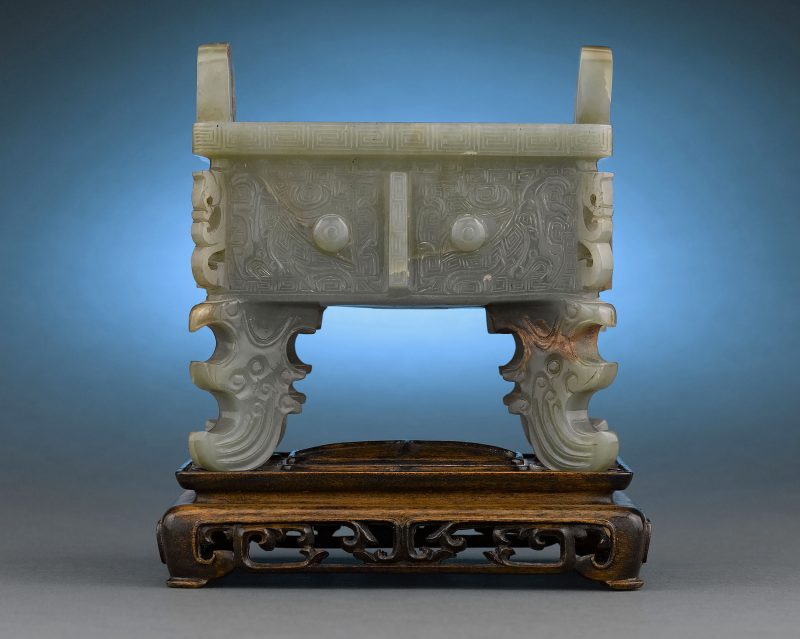 Delicately carved from jade with elaborate designs in bas and high relief, the present piece is a wonderful example of an truly ancient form