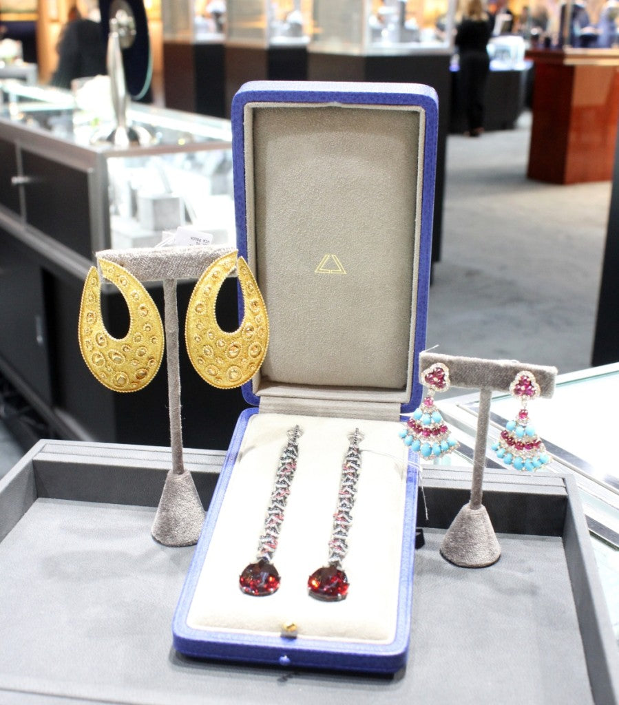 When asked what some of the highlights of his booth were, Greg Kwiat, Kwiat and Fred Leighton, New York City, showed off three sets of earrings. On the left was a pair of circa 1970s Van Cleef & Arpels gold earrings similar to ones Jackie Onassis owned; in the center is a pair of spinel, garnet, sapphire and diamond pendant earrings by contemporary London-based designer, Lauren Adriana; and on the right is a pair of circa 1970s Bulgari ruby and turquoise earrings. Kwiat sold the Bulgari earrings during the show.