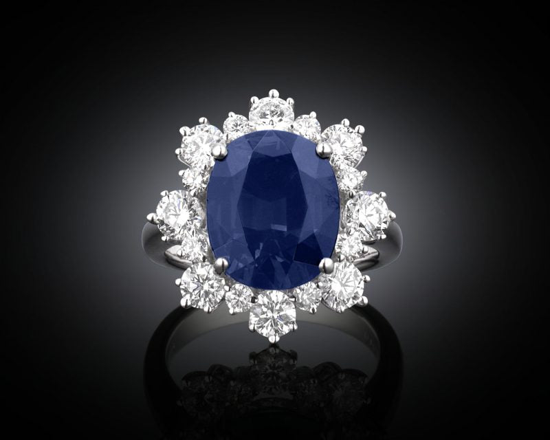 This 7.00 carat sapphire exhibits a stunning, deep blue hue