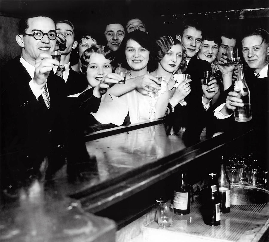 Party-goers toasting at a Prohibition-era speakeasy.