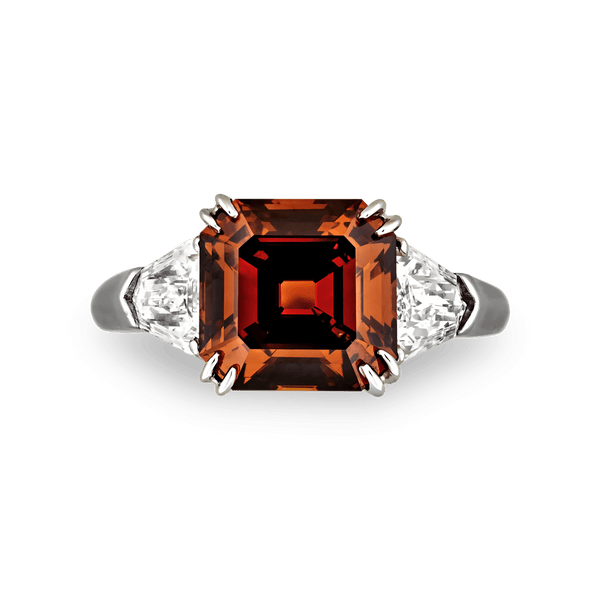 A rare fancy deep brown orange diamond radiates warmth and brilliance in this exquisite ring