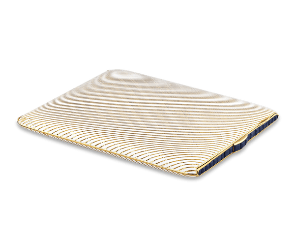 A line of channel-set blue sapphires add a luxurious touch to this French cigarette case