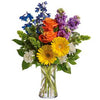 Send beautiful traditional flower arrangement dillivered in a vase