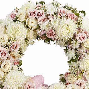 Loving funeral wreath of soft pastel blossoms