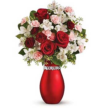 Buy vase full of mixed Christmas flowers