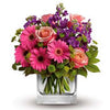 Send mixed spring garden flowers in a square vase