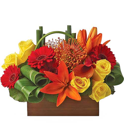 Buy vivid table flowers arrangement