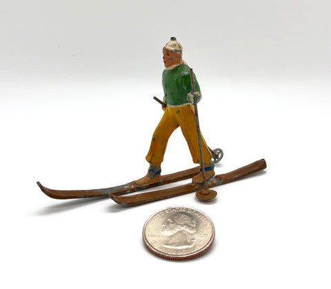 Vintage Toy Skier with quarter for scale