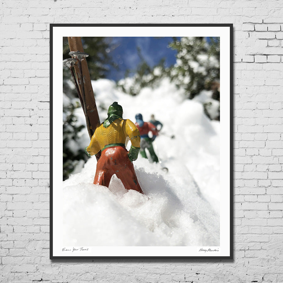 Framed photo of vintage toy skiers climbing to earn their turns by Hooey Mountain