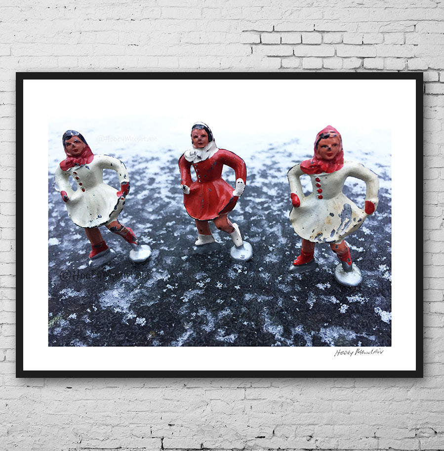 Vintage toy skaters on black ice photo by Hooey Mountain