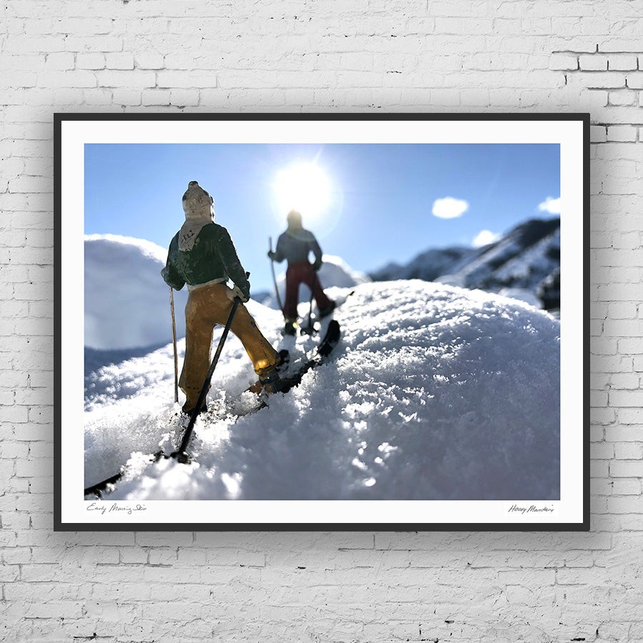 Framed photo of  vintage toy backcountry skiers in snow by Hooey Mountain