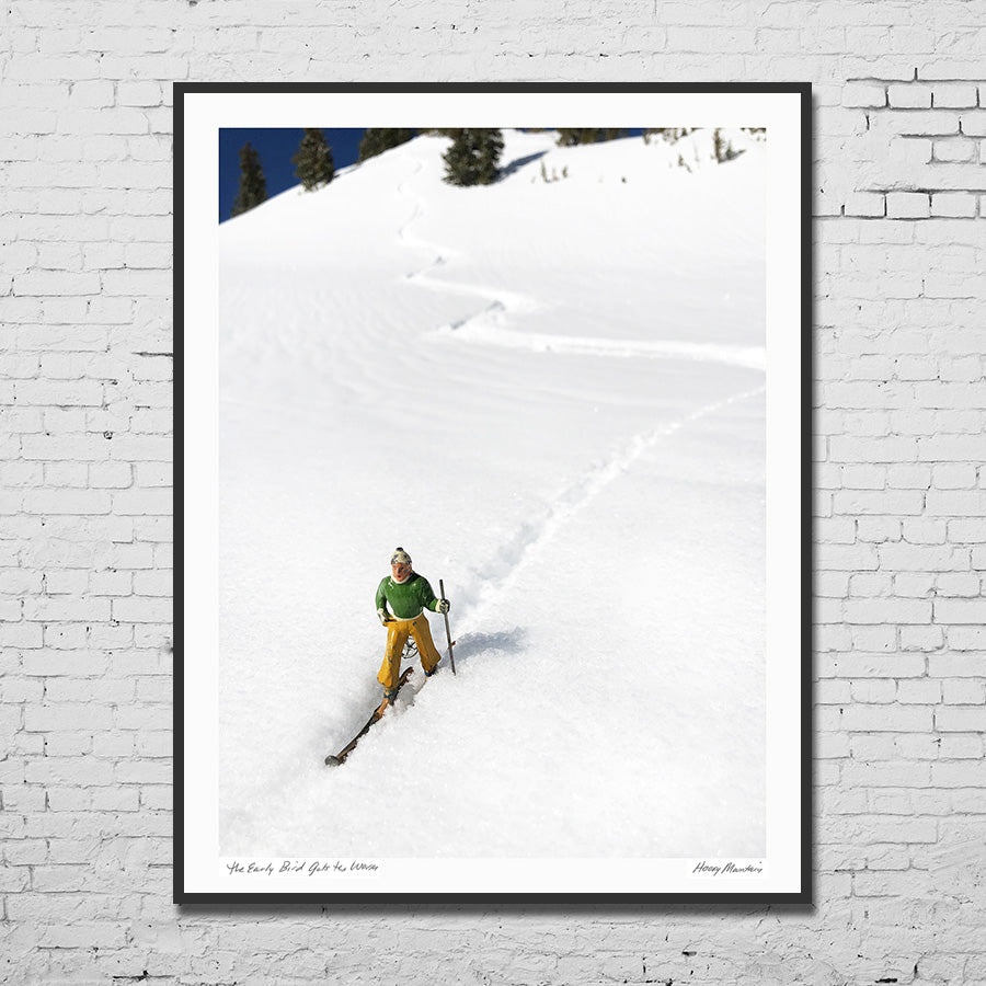 Framed photo of vintage toy skier on snowy mountains by Hooey Mountain