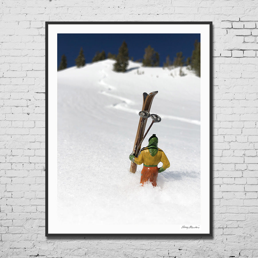 Vintage toy skier framed photographed in snow with ski trail by Hooey Mountain