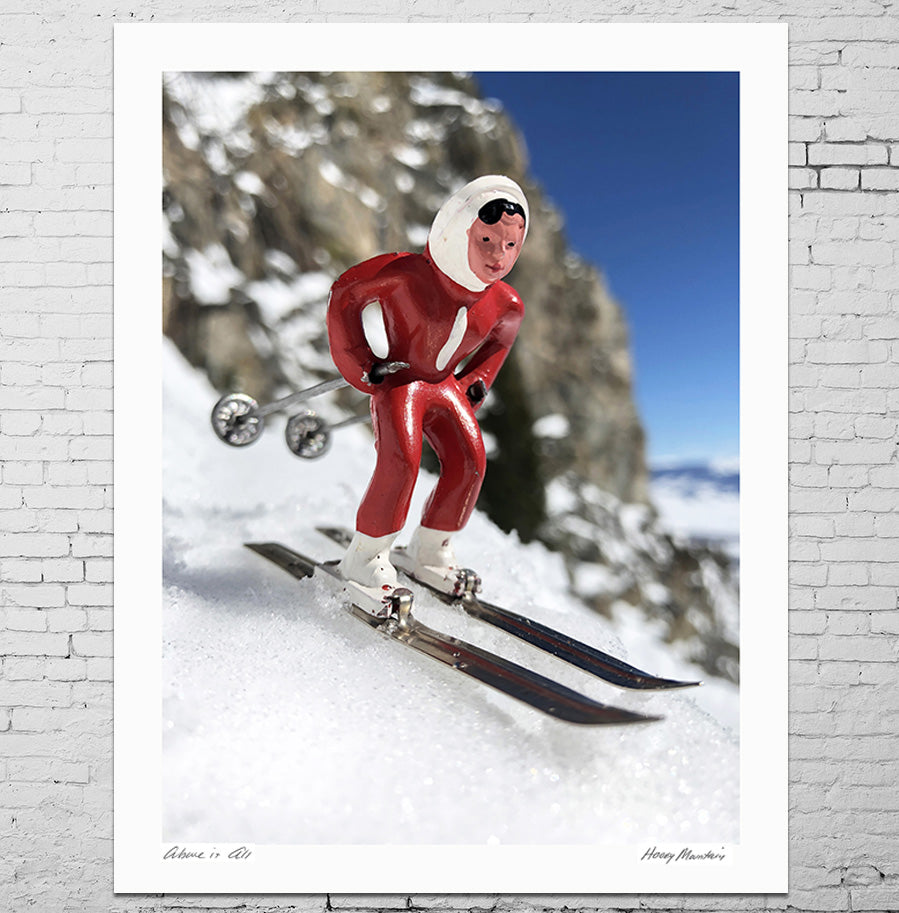 Photo of vintage toy skier on mountain with large rock by Hooey Mountain