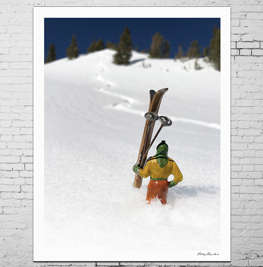 Vintage toy skier photographed in snow with ski trail by Hooey Mountain