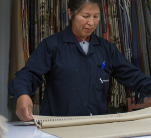social sustainability worker handling textiles in peru