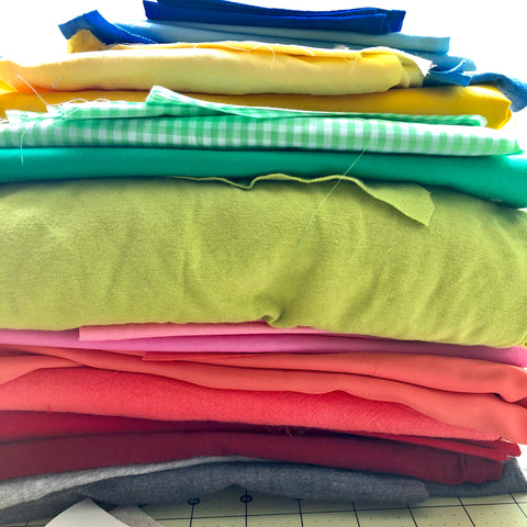 a rainbow of fabrics stacked