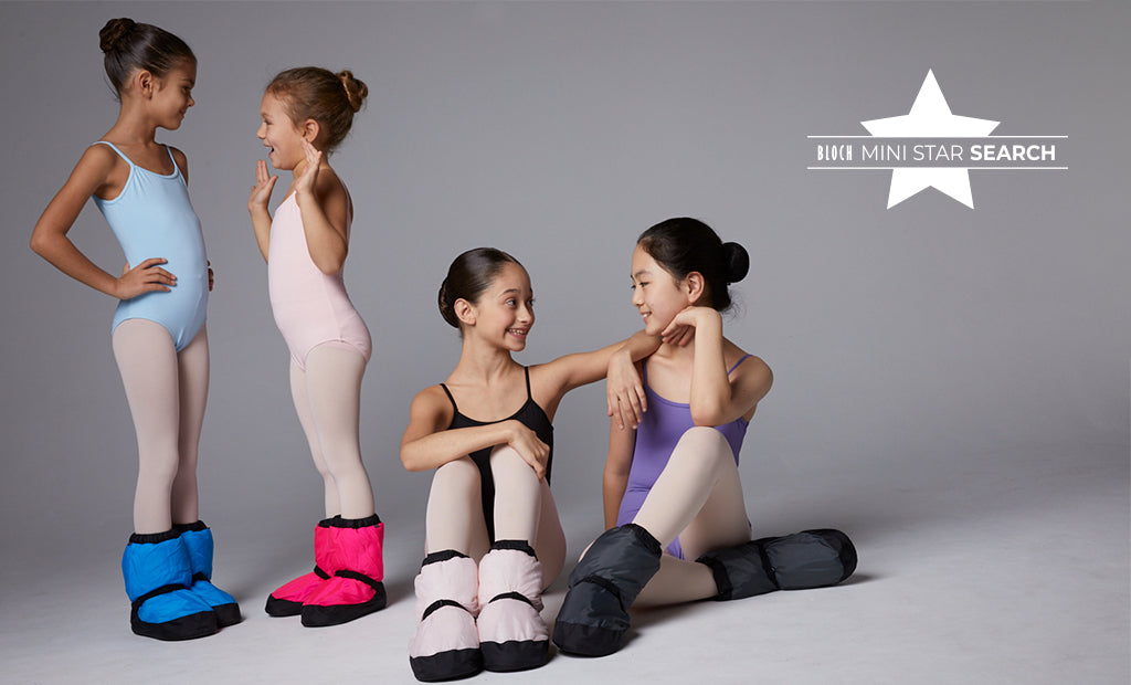 Four young ballet dancers chatting before ballet class, wearing BLOCH leotards, tights and Warm Up Booties