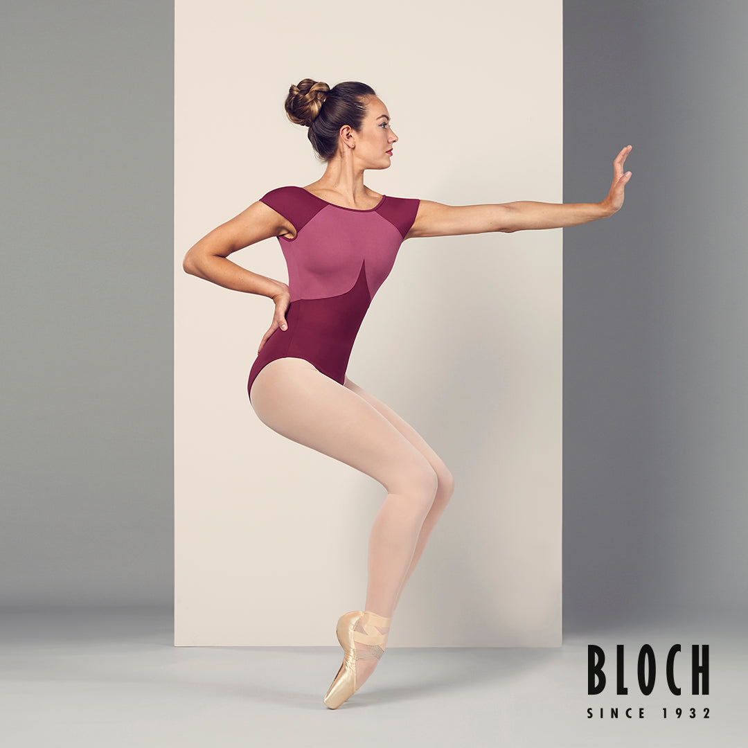 Ballet dancer Tierney Heap dancing wearing the Dhara scoop back cap sleeve leotard