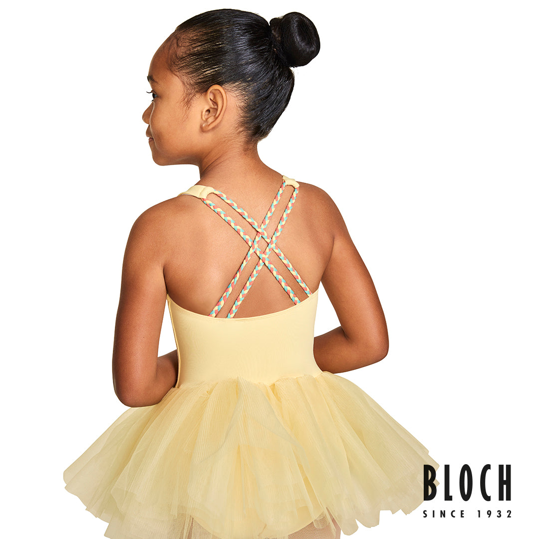 The back of a young ballet dancer wearing the Clara Gelato braid tutu leotard in sunshine yellow