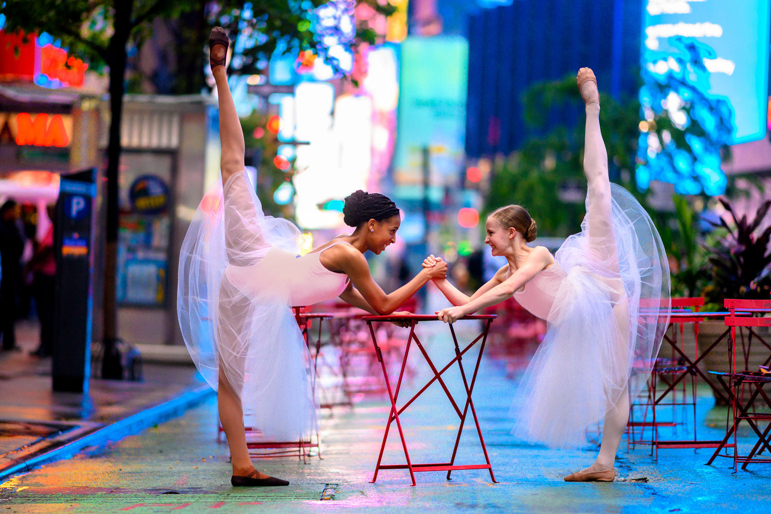 Two young dancers wearing BLOCH tutu and leotard dancing through New York City