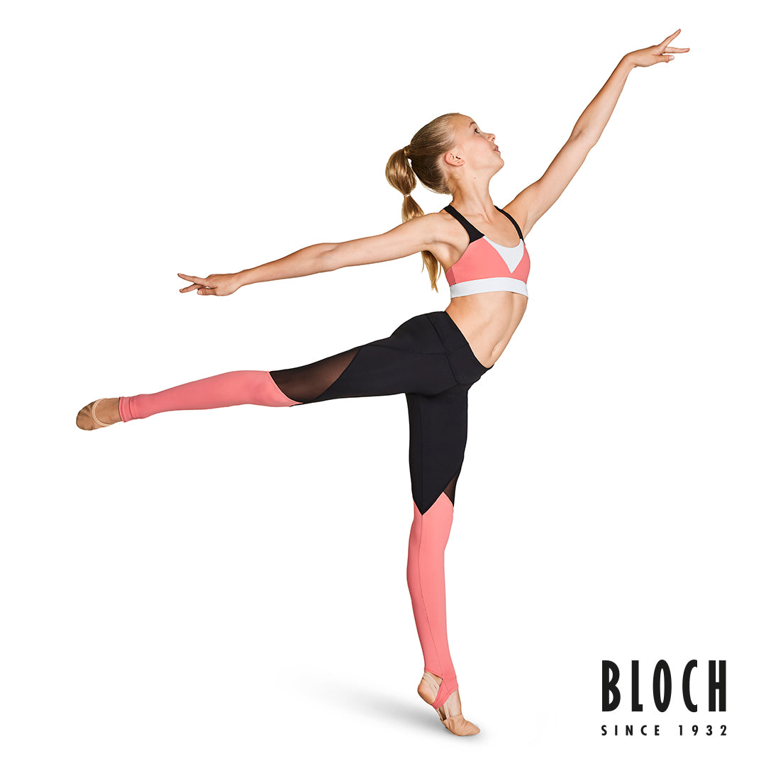 A young dancer wearing crop top and mesh panel leggings from the BLOCH Colour Bloch collection