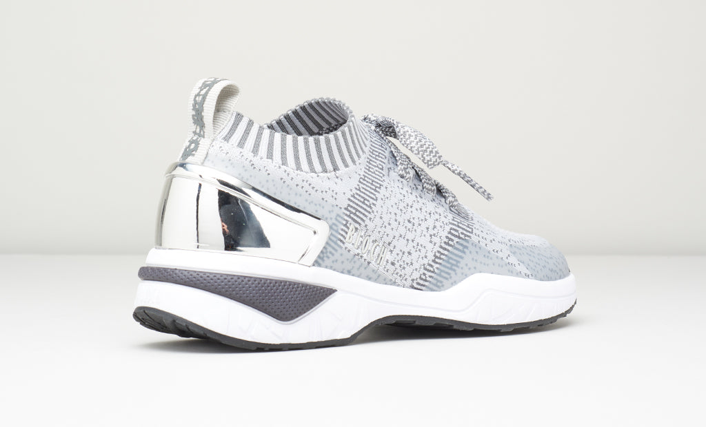 The back of an Alcyone dance sneaker in grey/silver