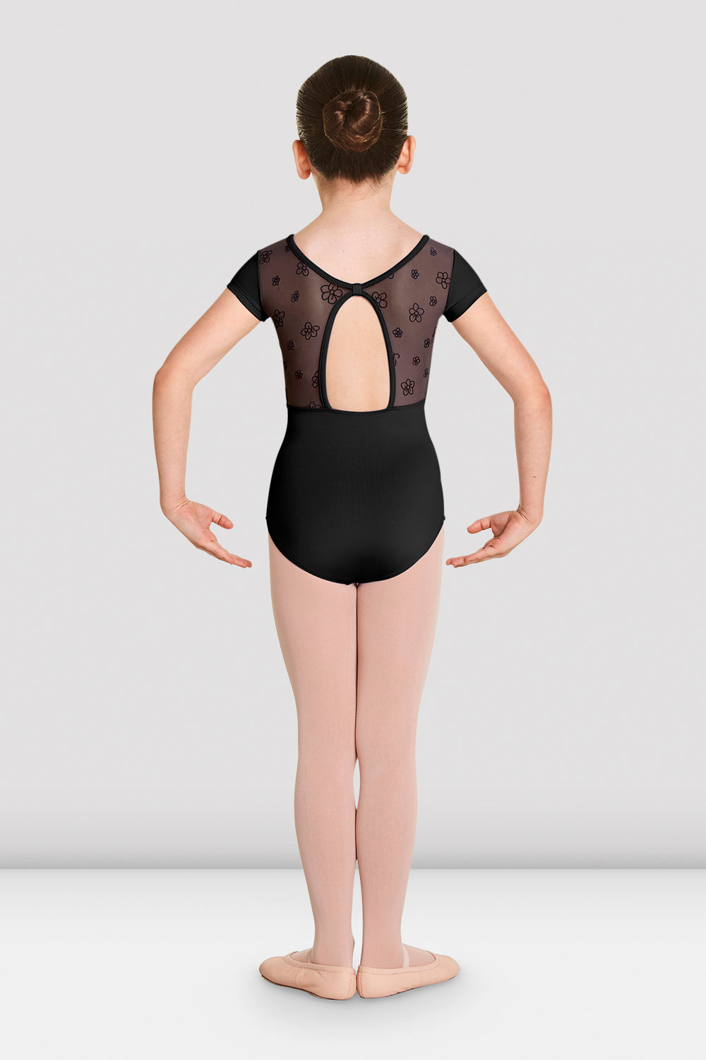 The back of a young female ballet dancer wearing the Girls Antheia short sleeve sweetheart leotard