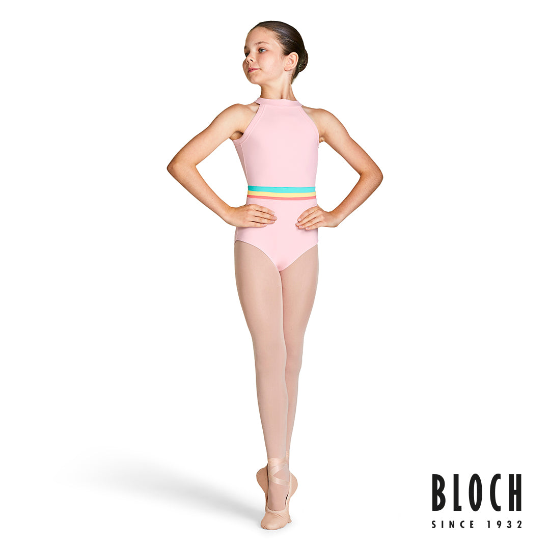 A young female dancer wearing the Aisha high neckline halter leotard in pink from the BLOCH Gelato spring collection