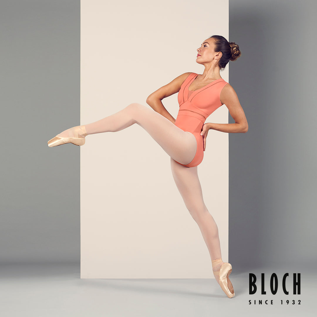 Ballet dancer Tierney Heap dancing in the Zahra leotard in shade Cantaloupe with pink tights and pointe shoes