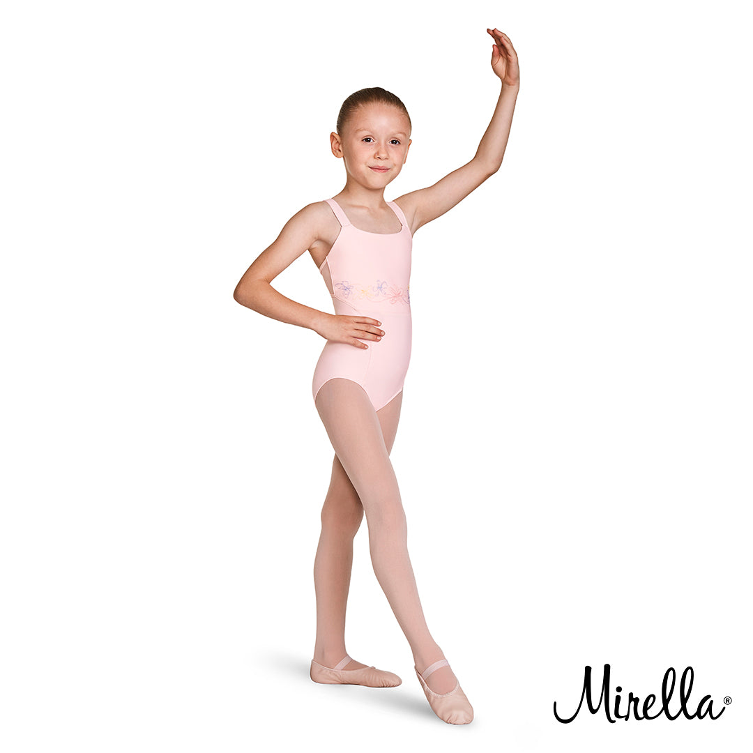 A young ballet dancer dancing wearing the Mirella open back camisole leotard in pink