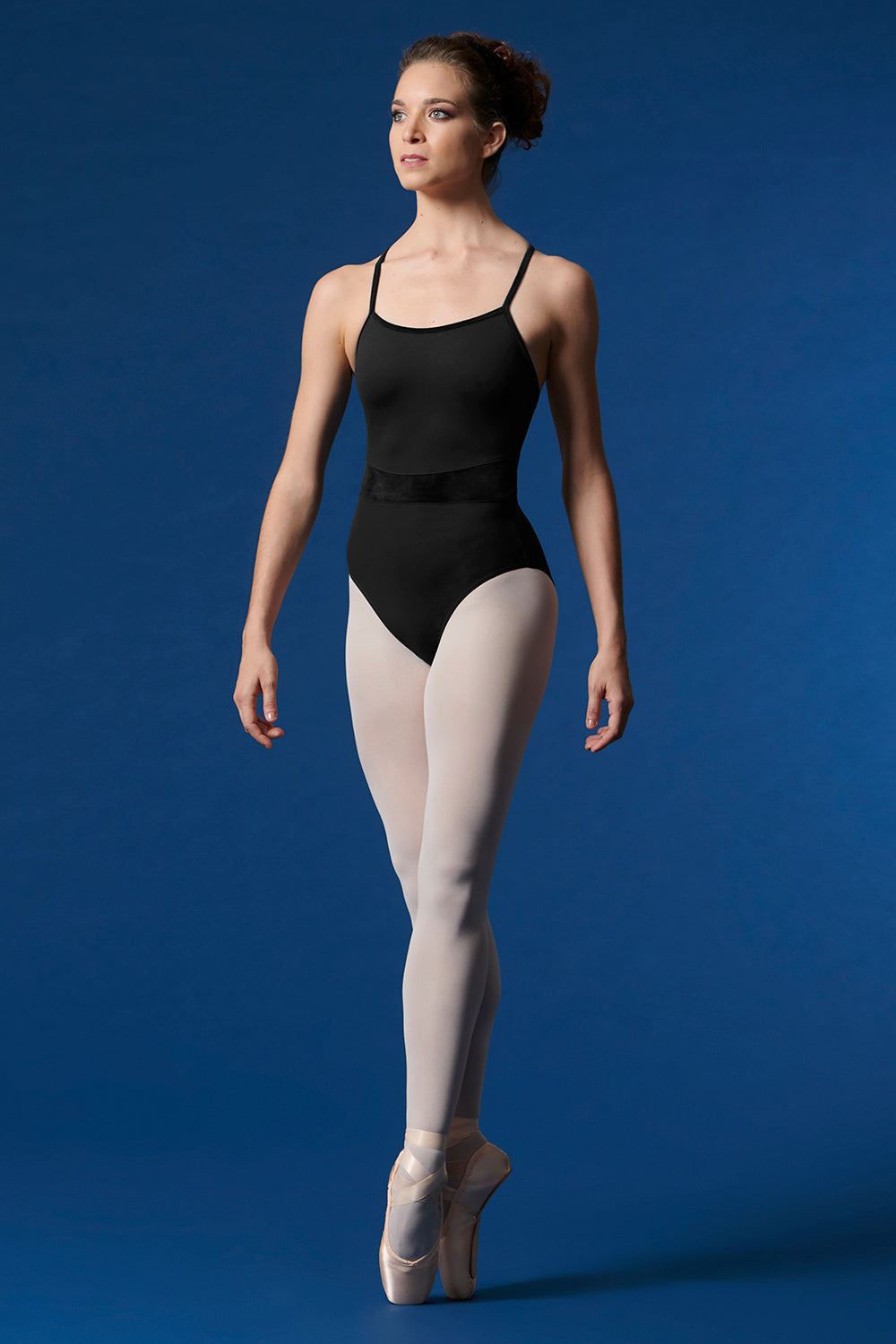 A ballet dancer en pointe wearing the Ladies Mirella Scoop Neck Velvet Leotard with tights