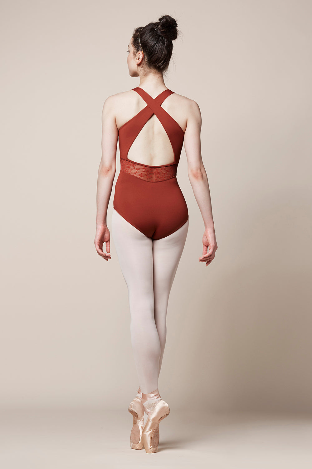 The back of a ballet dancer wearing