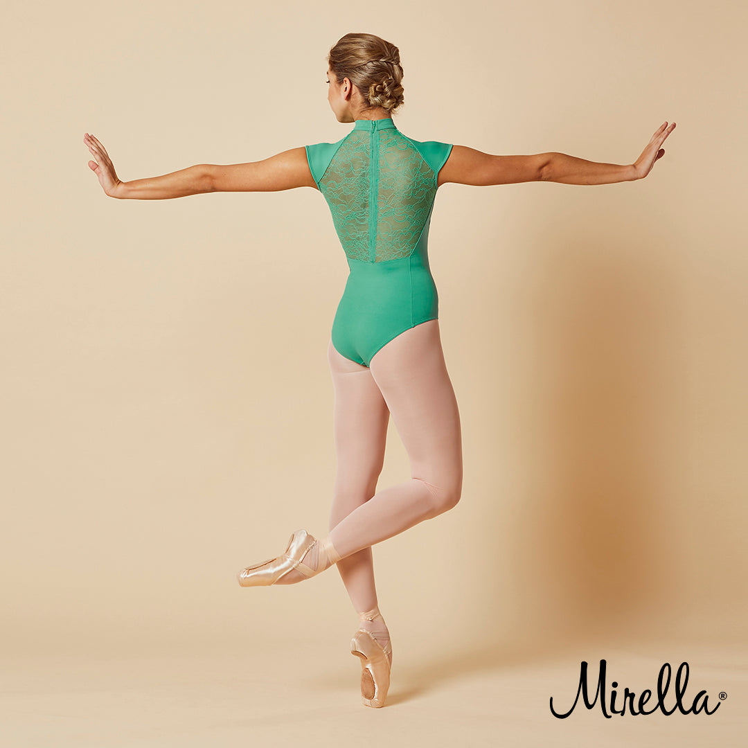 Ballet dancer Sasha Mukhamedov wearing the Mirella lace mesh zip back cap sleeve leotard in amazon green with pink tights and pointe shoes