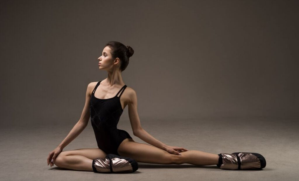 Ballet dancer Maria Khoreva in the studio wearing BLOCH leotard and Metallic Warm Up Booties