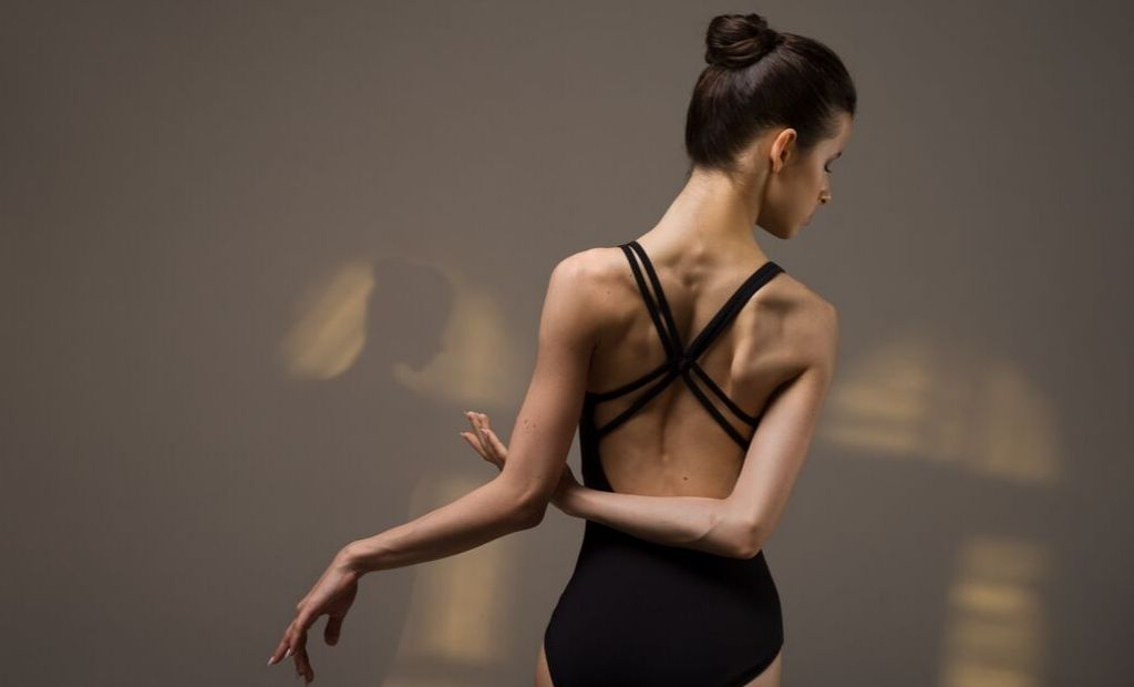 Ballet dancer Maria Khoreva dancing in the studio wearing a black BLOCH leotard